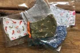 Two layers of cotton fabric with a pocket for an additional filter. Adult and child sizes available. Locally handmade. Random selection of fabric (many more than are pictured, please add your requests to the comment section before checkout.